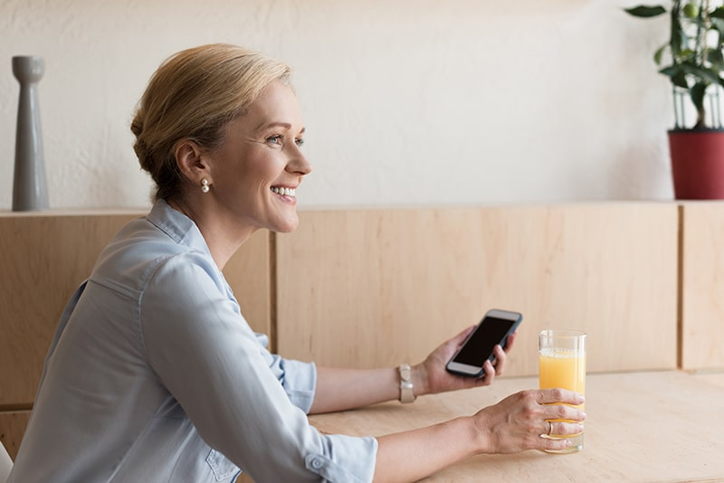 culver city apartments - home page - woman and orange juice
